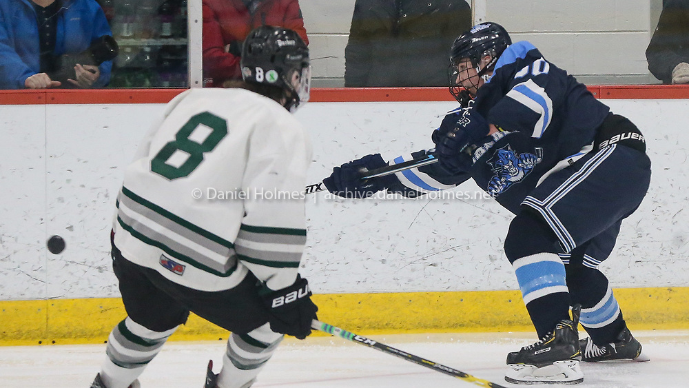 (3/10/19, BOURNE, MA) Franklin's Joe LeBlanc  clears the puck during the Division 1 South finals against Duxbury at Gallo Arena in Bourne on Sunday. [Daily News and Wicked Local Photo/Dan Holmes]