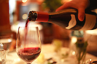 wine steward pouring red wine at Restaurant Piere Gagnaire, Paris