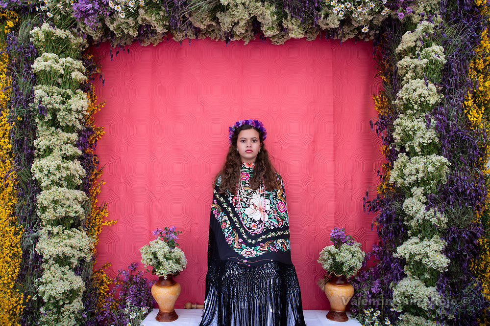Madrid, Spain. 6th May, 2018. Portrait of the 'Maya' Andrea sitting on her altar sourrounded by lavender, thyme and other wild flowers. © Valentin Sama-Rojo.