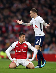 Arsenal's Alexis Sanchez, left looks dejected after being fouled by Tottenham Hotspur's Kieran Trippier, right