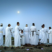 Samaritan people pray during a pilgrimage marking the holiday of Passover on Mount Gerizim on the outskirts of the West City of Nablus