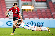 Mark Atkinson of Gloucester Rugby is tackled by Dan John of Exeter Chiefs during the Gallagher Premiership Rugby match between Gloucester Rugby and Exeter Chiefs at the Kingsholm Stadium, Gloucester, United Kingdom on 26 March 2021.
