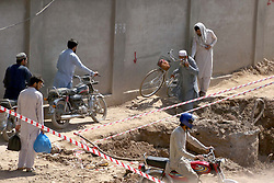 April 13, 2018 - Pakistan - PESHAWAR, PAKISTAN, APR 12: Commuters are facing inconvenience due to construction .work of Bus Rapid Transit Project as slow pace of construction work is creating problems for .residents and they demand to concerned department to complete work as soon as possible, at .Sher Shah Suri Road in Peshawar on Thursday, April 12, 2018. (Credit Image: © PPI via ZUMA Wire)