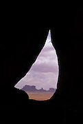 Teardrop Arch & view of Monument Valley, Navajo Tribal Park, Arizona.©1996 Edward McCain. All rights reserved. McCain Photography, McCain Creative, Inc..