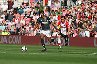 Football - 2017 / 2018 Premier League - Southampton vs. Manchester United<br /> <br /> Southampton's Cedric Soares grabs Marcus Rashford of Manchester United by the shirt whilst trying to stop the United striker at St Mary's Stadium Southampton<br /> <br /> COLORSPORT/SHAUN BOGGUST