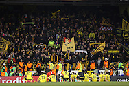 Borussia Dortmund fans celebrate after the final whistle as Borussia Dortmund players sit and watch the chanting. UEFA Europa League round of 16, 2nd leg match, Tottenham Hotspur v Borussia Dortmund at White Hart Lane in London on Thursday 17th March 2016<br /> pic by John Patrick Fletcher, Andrew Orchard sports photography.
