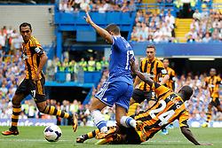 Chelsea's Eden Hazard is tackled by Hull City's Sone Aluko  - Photo mandatory by-line: Mitchell Gunn/JMP - Tel: Mobile: 07966 386802 18/08/2013 - SPORT - FOOTBALL - Stamford Bridge - London -  Chelsea v Hull City - Barclays Premier League