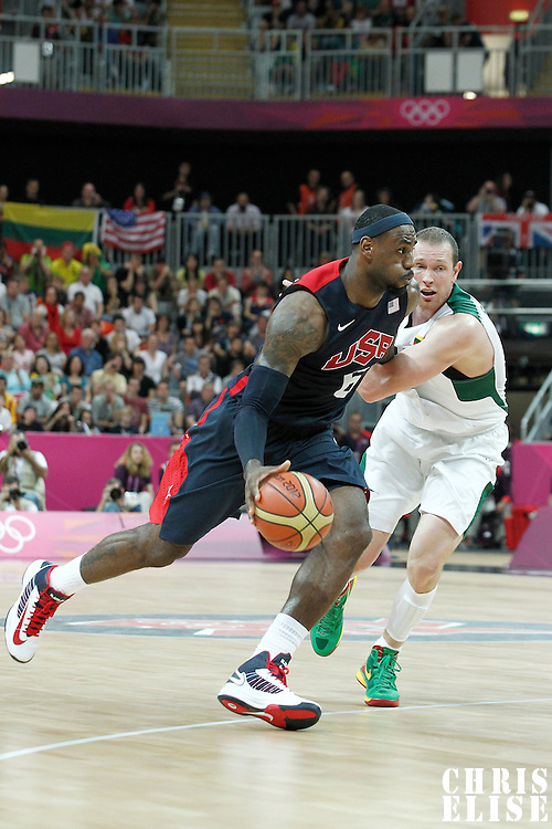 04 August 2012: USA LeBron James drives past Lithuania Darius Songaila during 99-94 Team USA victory over Team Lithuania, during the men's basketball preliminary, at the Basketball Arena, in London, Great Britain.