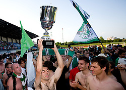 Adnan Alagic, Jernej Leskovar and David Kasnik at award ceremony celebrates with the Cup after final match of 2nd SNL league between NK Olimpija in NK Aluminij, on May 23, 2009, ZAK, Ljubljana, Slovenia. Aluminij won 2:1. NK Olimpija is a Champion of 2nd SNL and thus qualified to 1st Slovenian football league for season 2009/2010. (Photo by Vid Ponikvar / Sportida)