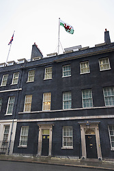 Downing Street, London, February 11th 2016. The Welsh flag flies over Downing Street on St David's Day. <br /> ©Paul Davey<br /> FOR LICENCING CONTACT: Paul Davey +44 (0) 7966 016 296 paul@pauldaveycreative.co.uk