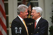 US President Bill Clinton embraces Peace Corp founder Sargent Shriver during and event to celebrate the 35th anniversary of the Peace Corp at a event in the Rose Garden of the White House June 19, 1997 in Washington, DC.