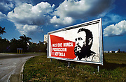 Poster of Fidel Castro with the message, More than ever, production and defense, June 1984, in the outskirts of Havanna, Cuba.<br /> Fidel Alejandro Castro Ruz was a Cuban revolutionary and politician who governed the Republic of Cuba as Prime Minister from 1959 to 1976 and then as President from 1976 to 2008. He was loved by most of the people as a champion of socialism and anti-imperialism whose revolutionary regime advanced economic and social justice while securing Cubas independence from American imperialism.