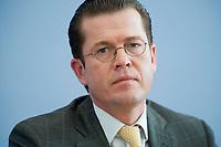 12 APR 2010, BERLIN/GERMANY:<br /> Karl-Theodor zu Guttenberg, CDU, Bundesverteidigungsminister, waehrend einer Pressekonferenz zur Vorstellung der Strukturkommission der Bundeswehr, Bundespressekonferenz<br /> IMAGE: 20100412-01-025