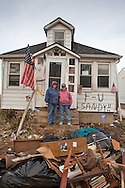 Union Beach NJ, November 16, Melissa Morgans=Johston and her friend  Rebecca Sacaloff stand outside Melissa's home that was destroyed by superstorm Sandy. Hurricane Sandy caused billions of dollars of damage. The superstorm is being blamed on climate change by many scientists.