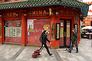 People out and about passing the New China restaurant in Chinatown on 25th May 2021 in London, United Kingdom. As the coronavirus lockdown continues its process of easing restrictions, more and more people are coming to the West End as more businesses open.