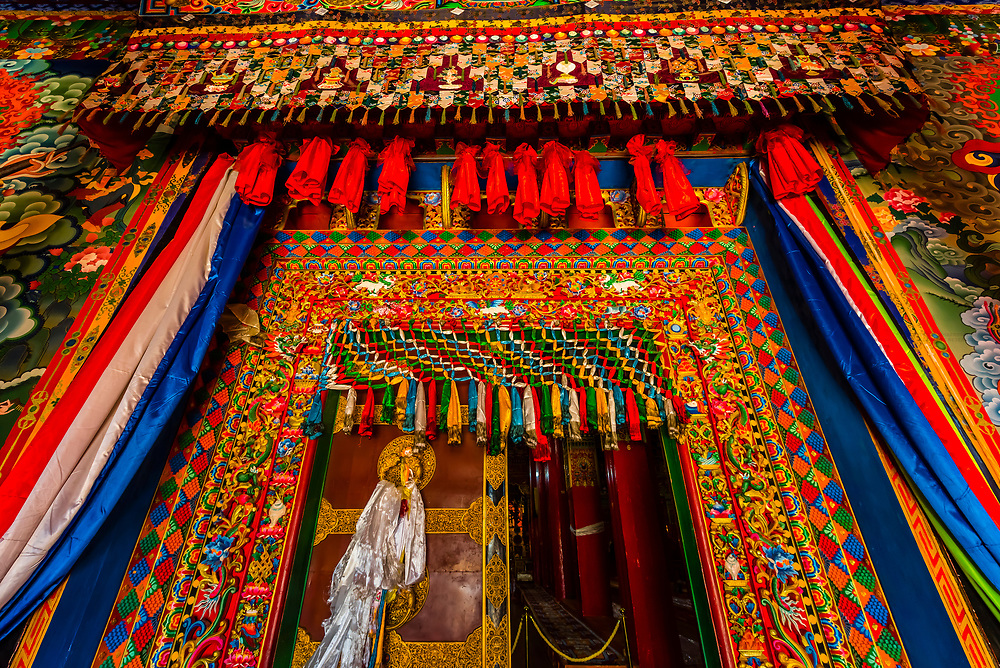 Entrance to a prayer hall at Songzanlin (Ganden Sumtsenling) Monastery, Shangri La, Yunnan Province, China. It is the largest Tibetan Buddhist monastery in Yunnan Province.