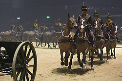 © Licensed to London News Pictures. 06/12/2013. London, England. Pictured: Musical Drive of the King's Troop Royal Horse Artillery. Op Cyber - Royal Marine Commandos during an operation.  The 2013 British Military Tournament is one of the largest displays of military theatre in the world and takes place at Earls Court from 7-8 December 2013. Photo credit: Bettina Strenske/LNP