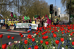 """© Licensed to London News Pictures. 15/04/2019. LONDON, UK.  People in the roads surrounding Marble Arch take part in """"London: International Rebellion"""", a protest organised by Extinction Rebellion, demanding that governments take action against climate change.  Marble Arch, Oxford Circus, Piccadilly Circus, Waterloo Bridge and Parliament Square have been blocked by activists.  According to the organiser, similar protests are taking place in 80 other cities around the world.  Photo credit: Stephen Chung/LNP"""