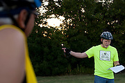 """Mayor Pro Tem Gerald Farris of Irving gives the pre-ride instructions before the first  """"Elected Officials bike ride"""" along the Champion Trail in Irving, Texas on August 6, 2013. Riders included nearly 15 mayors and council members from around north Texas with the aim to promote biking in their neighborhoods. (Cooper Neill / Texas Tribune)"""