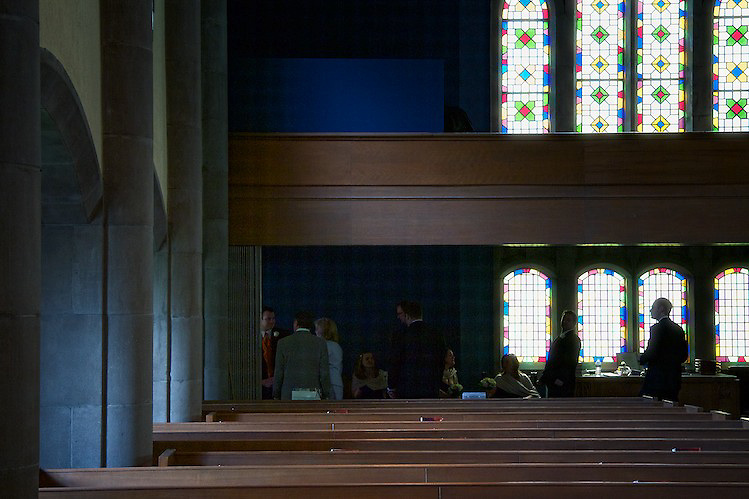 People gather inside the church. To view the newlywed's complete Wedding Gallery Collection, please visit the Client Area and log-in. You'll be able to view these and other images as a slideshow, order prints and more.