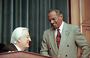 Chairman Rep. Henry Hyde talks with ranking minority member Rep. John Conyers during House Judiciary Committee hearings on whether impeachment proceedings should begin against President Bill Clinton October 5, 1998 in Washington, DC. This is only the third time in US history that impeachment proceedings against a President have been brought to the House committee.