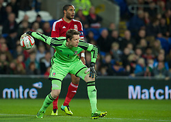CARDIFF, WALES - Saturday, November 16, 2013: Wales' goalkeeper Wayne Hennessey in action against Finland during the International Friendly match at the Cardiff City Stadium. (Pic by David Rawcliffe/Propaganda)