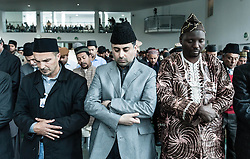 © Licensed to London News Pictures. 21/09/2012. London,UK.  Local muslims pray following a sermon by His Holiness Hadhrat Mirza Masrror Ahmad give a sermon at the Baitul Futuh Mosque in Morden, London, in the wake of  protests across the Islamic world against the film 'Innocence of Muslims'.  His Holiness Hadhrat Mirza Masrror Ahmad is the Khalifa and worldwide muslim leader for Islam.   The Baitul Futuh Mosque is the largest mosque in Europe.  Photo credit : Richard Isaac/LNP