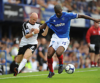 Fotball<br /> England<br /> Foto: Fotosports/Digitalsport<br /> NORWAY ONLY<br /> <br /> Sylvain Distin (Portsmouth) tussles with Andy Johnson (Fulham) <br /> <br /> 15.08.09 Portsmouth v Fulham Barclays Premier League Fratton Park