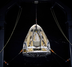 The SpaceX Crew Dragon Resilience spacecraft is lifted onto the GO Navigator recovery ship after it landed with NASA astronauts Mike Hopkins, Shannon Walker, and Victor Glover, and Japan Aerospace Exploration Agency (JAXA) astronaut Soichi Noguchi aboard in the Gulf of Mexico off the coast of Panama City, Florida, Sunday, May 2, 2021. NASA's SpaceX Crew-1 mission was the first crew rotation flight of the SpaceX Crew Dragon spacecraft and Falcon 9 rocket with astronauts to the International Space Station as part of the agency's Commercial Crew Program. Photo by Bill Ingalls / NASA via CNP /ABACAPRESS.COM