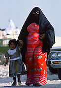 Qatari woman and child, Qatar.