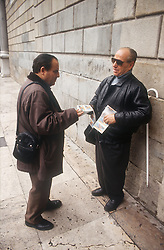 Man selling ONCE lottery tickets which is organisation for people with visual impairments that raises funds and provides employment,