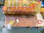 A worker cleans crab traps at Abner's Crab House in Chesapeake Beach, Maryland.