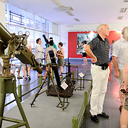 At left, various field artillery pieces are on display in a room at the War Remnants Museum in Ho Chi Minh City (Saigon), Vietnam.