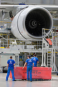 The expensive giant engines, in this case Rolls-Royce Trent, are mounted only days before roll-out.