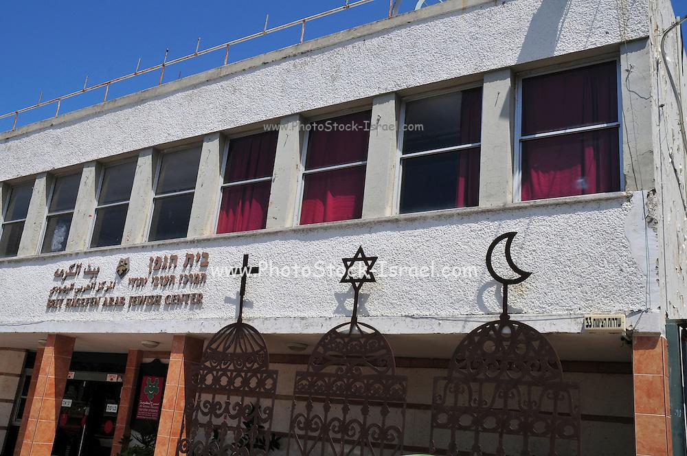 Israel, Haifa, The signs of the three major religions, Christianity, Judaism and Islam at Beit Hagefen Arab, Jewish Center