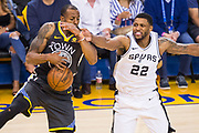 Golden State Warriors forward Andre Iguodala (9) battles for the ball against San Antonio Spurs forward Rudy Gay (22) during Game 2 of the Western Conference Quarterfinals at Oracle Arena in Oakland, Calif., on April 16, 2018. (Stan Olszewski/Special to S.F. Examiner)