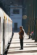 sao bento train station man standing waiting porto portugal