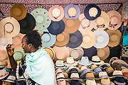Inca, Mallorca, African lady selling hats on the Inca local market