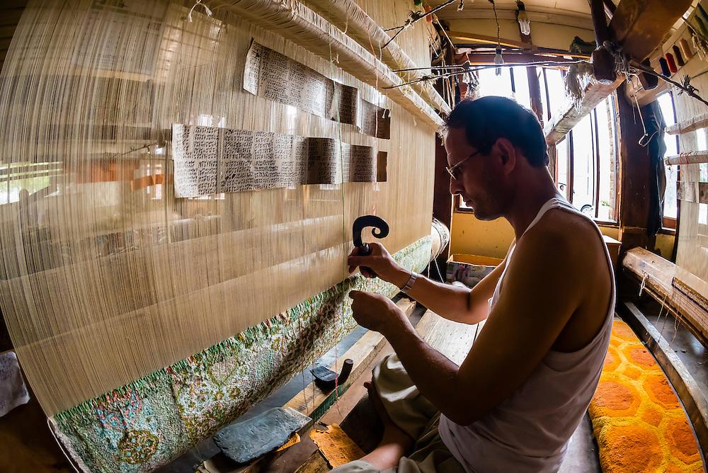 An artisan handweaving Kashmiri carpets, Ali Shah Carpets, Srinagar, Kashmir, Jammu and Kashmir State, India.