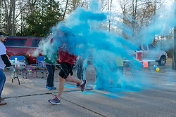 March 23, 2019 - Vernon, Alabama, U.S. - The color stations splash runners with colored powder as people run in a 5K color run in Vernon, Alabama. (Credit Image: © Tim ThompsonZUMA Wire)