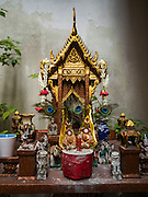 22 MARCH 2016 - BANGKOK, THAILAND: A spirit house in Verng Nakorn Kasem. Verng Nakorn Kasem, also known as the Thieves' Market, was one of Bangkok's most famous shopping districts. It is located on the north edge of Bangkok's Chinatown district, it grew into Bangkok's district for buying and selling musical instruments. The family that owned the land recently sold it and the new owners want to redevelop the famous area and turn it into a shopping mall. The new owners have started evicting existing lease holders and many of the shops have closed. The remaining shops expect to be evicted by the end of 2016.          PHOTO BY JACK KURTZ