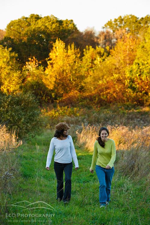 Two women walk in a field at Elmwood Farm in Hopkinton, Massachusetts. Fall.