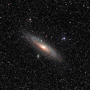 The Andromeda Galaxy (Messier 31) is a barred spiral galaxy in the constellation Andromeda about 2.5 l.y. away and about 220 000 l.y. across.