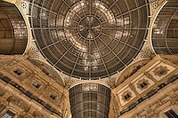 The Galleria Vittorio Emanuele II is one of the world's oldest shopping malls. Housed within a four-story double arcade in central Milan,  the Galleria is named after Vittorio Emanuele II, the first king of the Kingdom of Italy. It was designed in 1861 and built by Giuseppe Mengoni between 1865 and 1877.