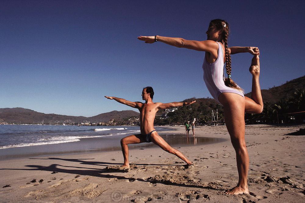 Early morning yoga on the beach at Zihuatanejo, Mexico.