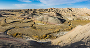 Yellow Mounds Overlook. Erosion has exposed layers of ancient colorful sediments. Badlands National Park has the largest undisturbed mixed grass prairie in the United States. South Dakota, USA. This image was stitched from multiple overlapping photos.