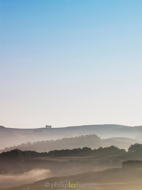 The beautiful, hilly landscape of Tuscany at dawn near Montalcino, Italy