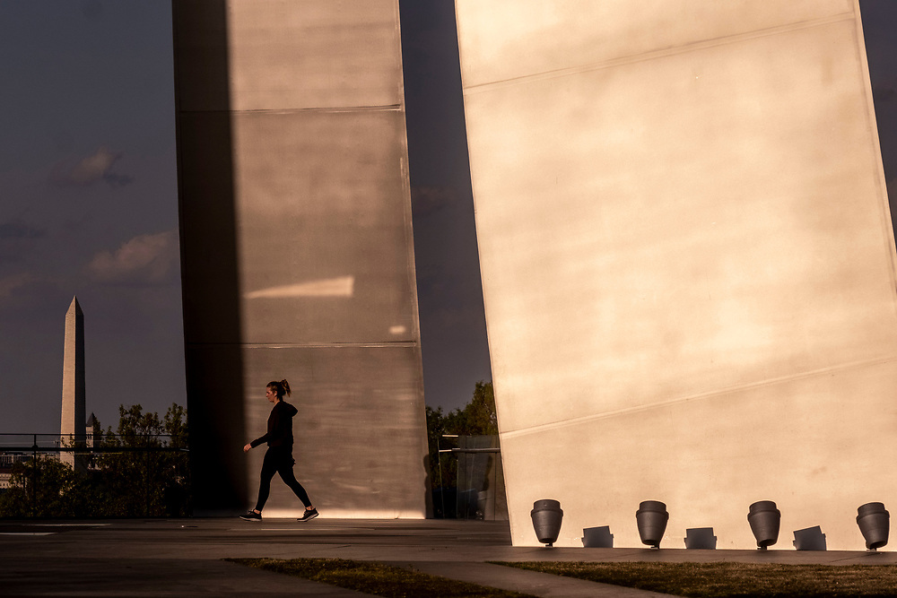 ARLINGTON, VA - APRIL 20: A woman walks around the US Air Force Memorial on Monday, April 20, 2020 in Arlington, Va. (Photo by Jay Westcott/ARLnow.com)
