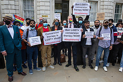 Campaigners against LGBT+ conversion therapy, including veteran LGBT+ and human rights campaigner Peter Tatchell and Jayne Ozanne of the Ban Conversion Therapy Coalition, attend a picket outside the Cabinet Office and Government Equalities Office on 23rd June 2021 in London, United Kingdom. They also handed in a petition signed by 7,500 people calling on the government to fulfil its promise made in July 2018 to ban LGBT+ conversion therapy. LGBT+ conversion treatments, which have been linked to anxiety, depression and self-harm, have been condemned by major UK medical, psychological and counselling organisations.