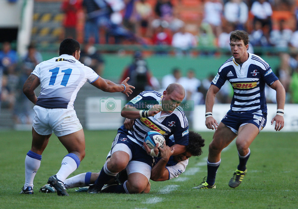 Wicus Blaauw of the Stromers is tackled by Sam Wykes of the Force with Danie Poolman (Stormers) and David Smith (Force) in support during the Super Rugby (Super 15) fixture between DHL Stormers and the The Force played at DHL Newlands in Cape Town, South Africa on 26 March 2011. Photo by Jacques Rossouw/SPORTZPICS